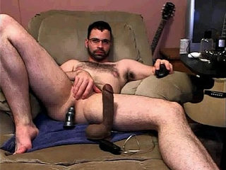 Enjoying a huge dildo | dildo   enjoying   feet top   huge gay